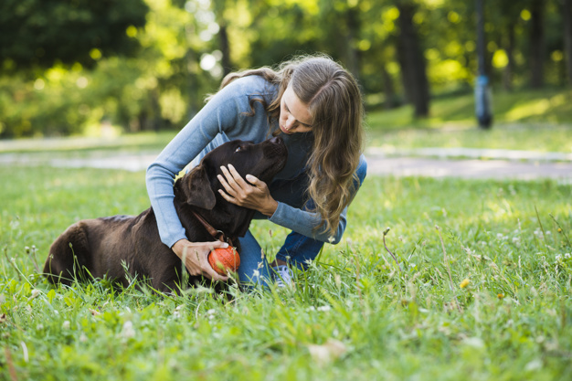 young-woman-with-her-dog-in-park
